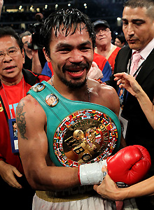 Pacquiao clobbers Margarito for eighth title